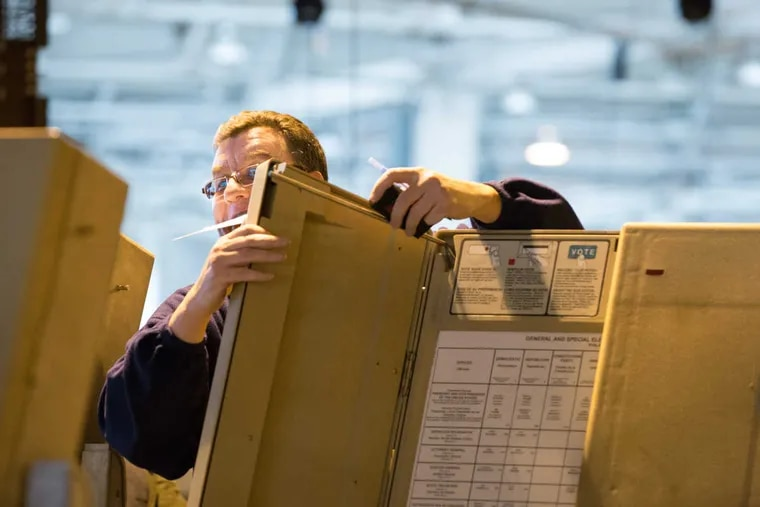 Civil service employee Joe Lynch works on an audit to recanvass the votes in 75 precincts at the City Commissioners' warehouse on Friday.