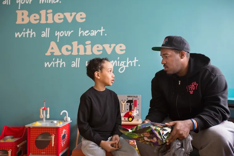 """Cancer patient Zahir Berry, 7, meets Al Harris, who founded """"Cancer Who?"""" as an organization to support those like Zahir who are dealing with cancer and its treatments. Some are children, some are adults."""