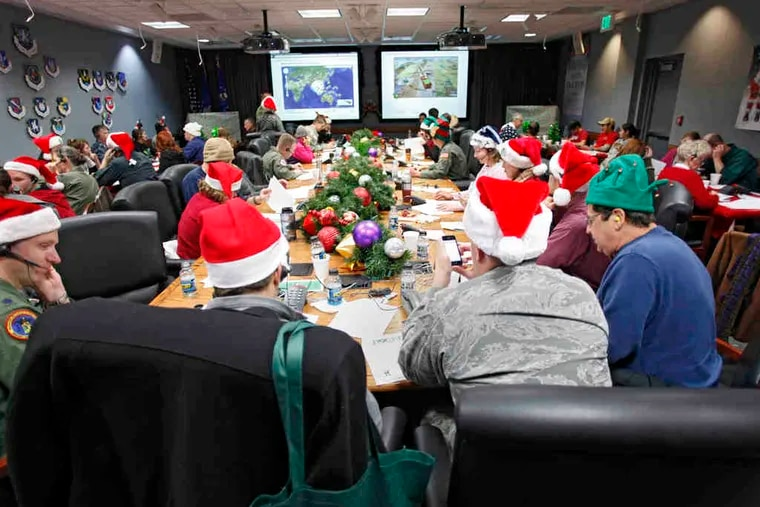 Santa trackers field calls and answer e-mails at NORAD Tracks Santa, Peterson Air Force Base, Colo. Tracking Santa's travels is a celebrated tradition in its 55th year.