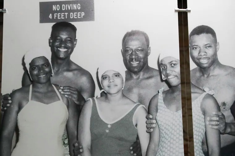 """A historic photo taken at the Fairmount Water Works Pool is on display for the upcoming """"POOL: A Social History of Segregation"""" exhibit at the Fairmount Water Works in Philadelphia on Wednesday, Aug. 25, 2021. The exhibit explores the history and current day implications of segregated swimming in America. It is set to open on the first week of September."""