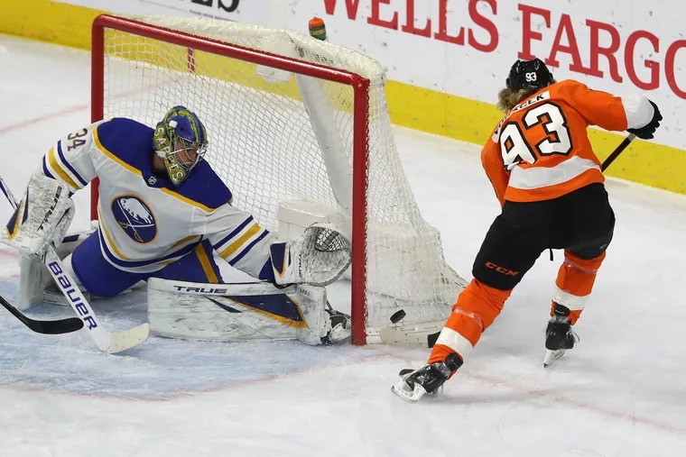 Buffalo goalie Jonas Johansson makes a great stop on the Flyers' Jake Voracek during the first period Tuesday.