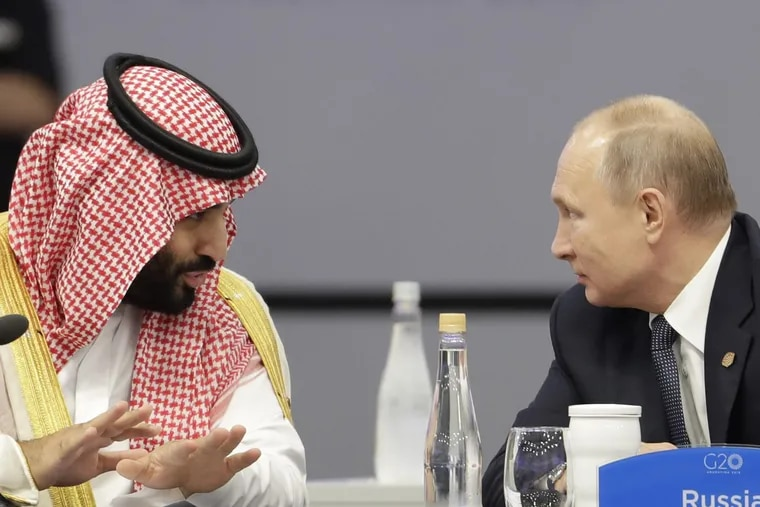 Saudi Arabia's Crown Prince Mohammed bin Salman, left, and Russia's President Vladimir Putin speak at the start of the G20 summit in Buenos Aires, Argentina, Friday, Nov. 30, 2018. The two leaders are controversial figures at the summit. In Putin's case, other world leaders have expressed concern over Russia's recent seizure of Ukrainian ships and their crews near Crimea. For the prince, it's about the killing of a dissident Saudi journalist in the country's Istanbul consulate. Saudi Arabia denies that bin Salman ordered the killing, but U.S. intelligence agencies have concluded the opposite. (AP Photo/Natacha Pisarenko)
