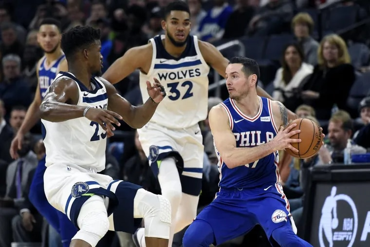 Jimmy Butler and Karl-Anthony Towns (32) guard JJ Redick (17) during the Philadelphia 76ers' 118-112 overtime win at the Minnesota Timberwolves.