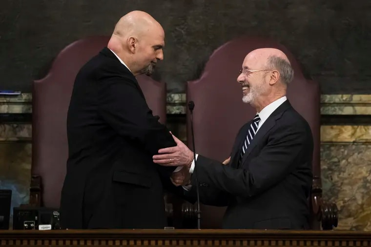 Gov. Tom Wolf, right, shakes hands with Lt. Gov. John Fetterman before he delivers his budget address for the 2019-20 fiscal year to a joint session of the Pennsylvania House and Senate in Harrisburg, Pa., Tuesday, Feb. 5, 2019.