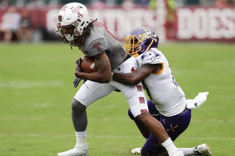Temple wide receiver Isaiah Wright runs with the football against East Carolina defensive back Daniel Charles on Saturday, October 6, 2018. YONG KIM / Staff Photographer