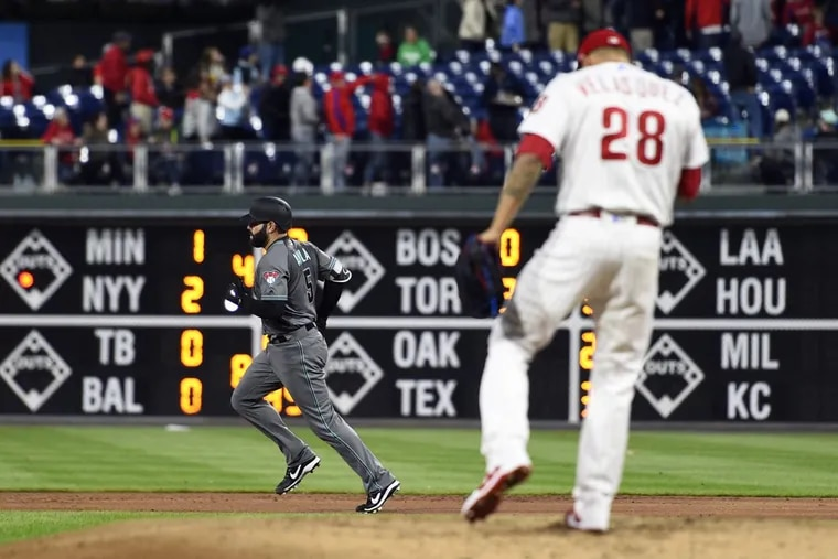 Phillies pitcher Vince Velasquez reacts to Diamondbacks' catcher Alex Avila (left) rounding the bases after a solo home run during the Phillies 8-4 loss on Tuesday.