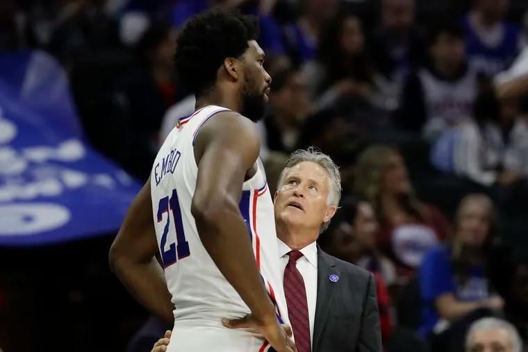 Sixers coach Brett Brown looks up at center Joel Embiid late in the fourth quarter.
