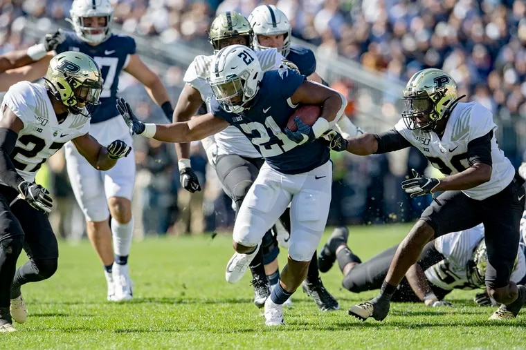 Purdue defenders can't stop Penn State running back Noah Cain (21), who finished with 105 yards on 12 carries, on Oct. 5.