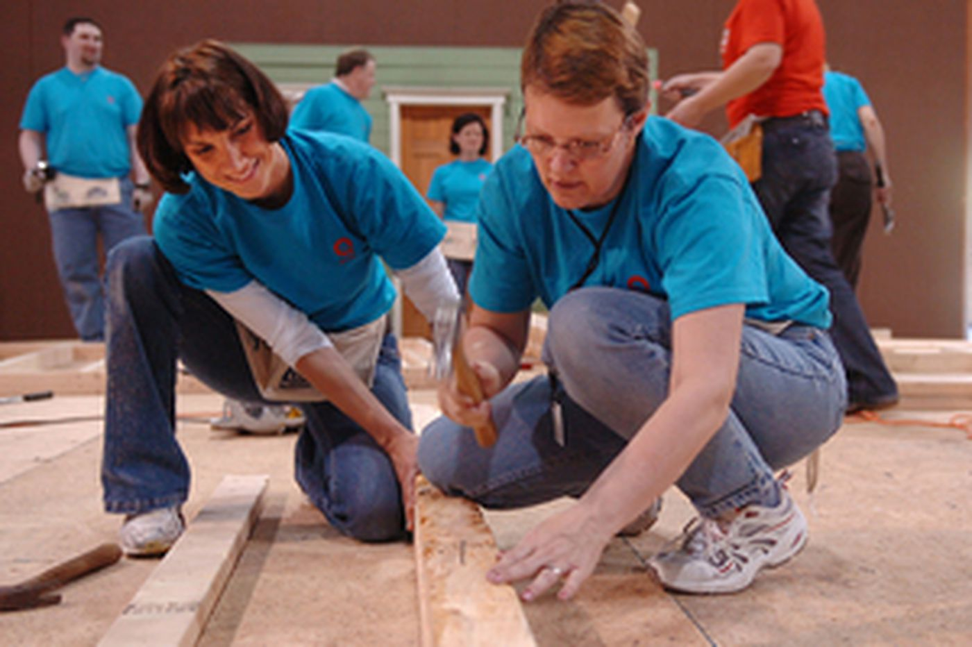 QVC workers swing the hammer for Habitat