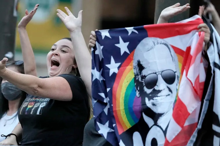 Supporters of Joe Biden dance to YMCA as they laugh and make gestures towards Trump supporters positioned on the opposite side of Arch St. in front of the Pennsylvania Convention Center in Phila., Pa. on Nov. 8, 2020.