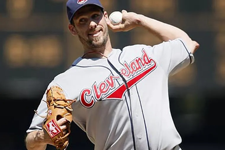 Baseball sources believe that a package of second-tier prospects like pitcher Carlos Carrasco and infielder Jason Donald might be sufficient to pry pitcher Cliff Lee from Cleveland. (John Froschauer / AP)