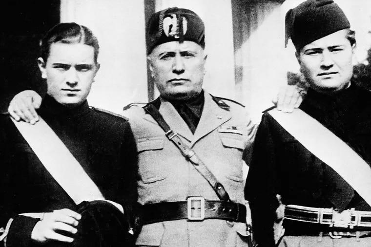 Italian dictator Benito Mussolini with his sons, Bruno (left) and Vittorio, in Rome in 1935.
