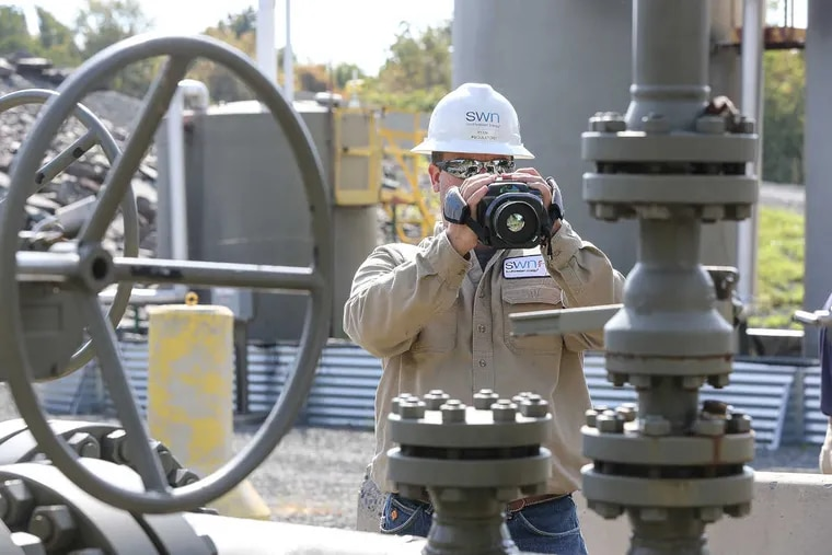 Ryan Klemish scans a well site in New Milford Township, Pa., for gas leaks with an infrared camera.