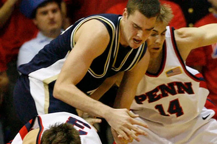 Penn's Tyler Bernardini (3), Larry Loughery go after loose ball with Navy's Mark Veazey at Palestra.