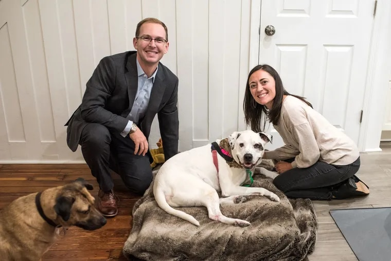 In September, Britney Kennedy and Doug Bobrow adopted Bentley, center, the PSPCA's longest resident at the time. He's the newest addition to the couple's family, which also includes Butters, left, Bentley's new favorite friend.