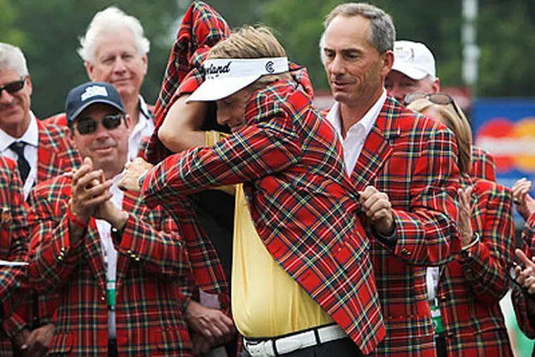 David Toms had some trouble putting on the winner's jacket after his triumph at The Colonial. (LM Otero/AP)