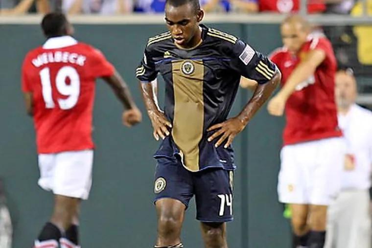 The Union's Amobi Okugo walks away after United's Gabriel Obertan scored. (Steven M. Falk / Staff Photographer)