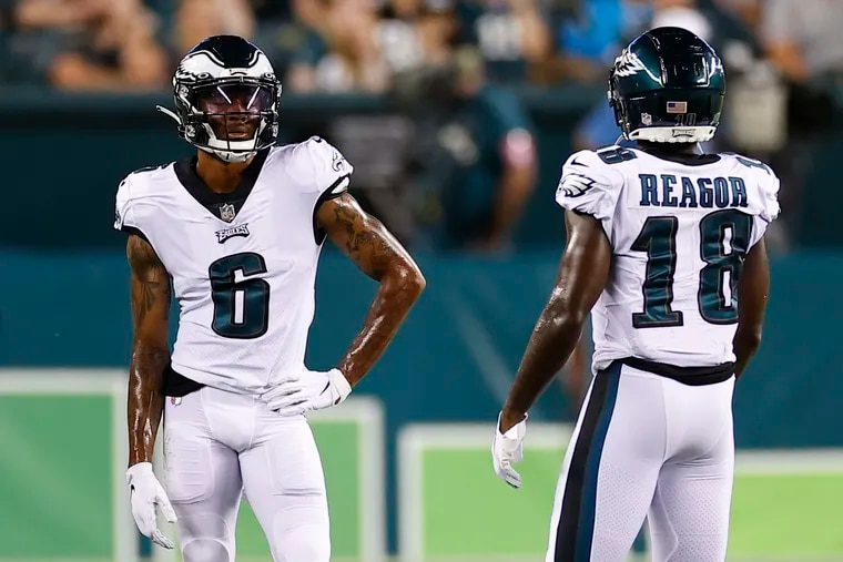 Eagles wide receivers DeVonta Smith and Jalen Reagor during a break against the New England Patriots in a preseason game last month.
