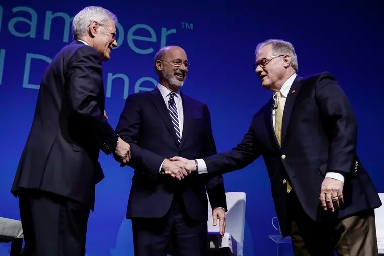 Democratic Gov. Tom Wolf, center, and Republican Scott Wagner, right, shake hands as moderator Alex Trebek looks on at a gubernatorial debate in Hershey, Pa., Monday, Oct. 1, 2018. The debate is hosted by the Pennsylvania Chamber of Business and Industry.