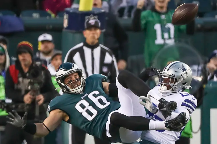 Tight end Zach Ertz is brought down by Dallas Cowboys safety Xavier Woods in the first quarter of the Eagles' 17-9 win on Sunday at Lincoln Financial Field.