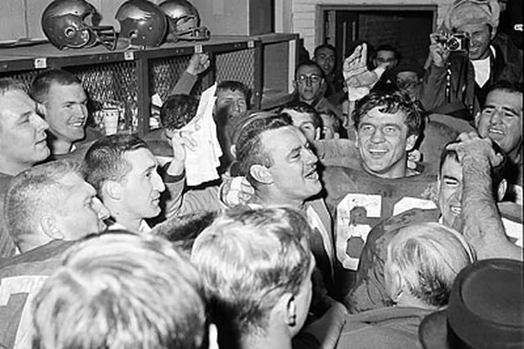 Norm van Brocklin (center) celebrates with his teammates after the Eagles won the 1960 NFL championship. (AP Photo)