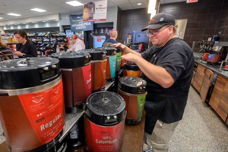 John Mitchell, a long-time Wawa employee with developmental disabilities, tends to the coffee station at the South Philadelphia Columbus Blvd. store, October 21, 2019.