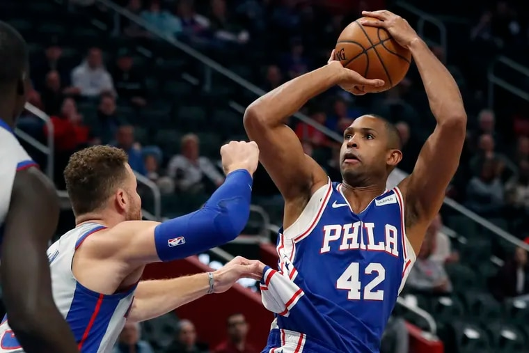 The Sixers' Al Horford (42) shoots over Pistons forward Blake Griffin during the first half Monday night.