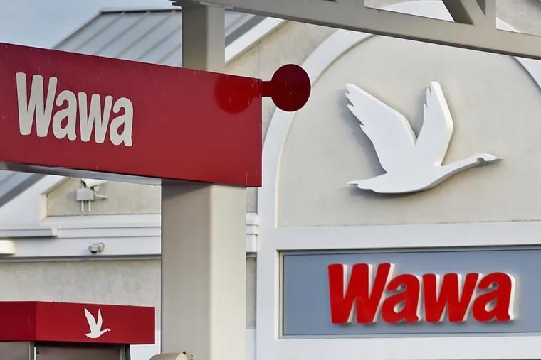 Company logos at a super-sized Wawa convenience-store-and-gas-station combo at 2535 Aramingo Avenue November 6, 2017.