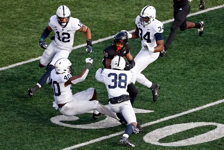 Rutgers wide receiver Bo Melton is tackled by Penn State safety Lamont Wade (38) on Saturday.