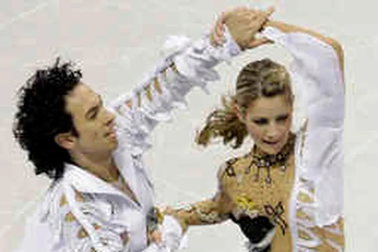 U.S. ice dancers Tanith Belbin and Benjamin Agosto set their sights on an Olympic medal. Due to a housing problem, Belbin is sharing a suite with Johnny Weir.