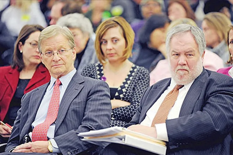 """Thomas Knudsen (left), the district's """"chief recovery officer,"""" and former district CFO Michael Masch (right), who is now a """"special adviser"""" to Knudsen. (Sarah J. Glover / Staff Photographer)"""