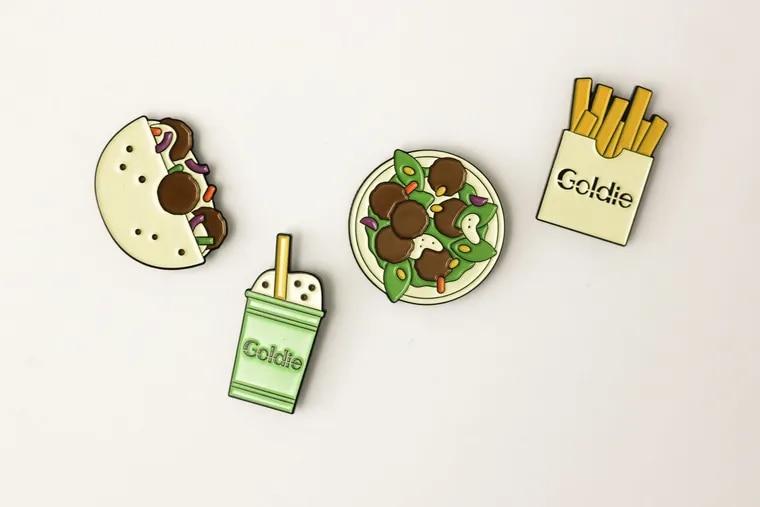 Local illustrator Lauren Cat West on a series of pins showcasing favorites from Goldie, Michael Solomonov's fast-casual falafel restaurant.