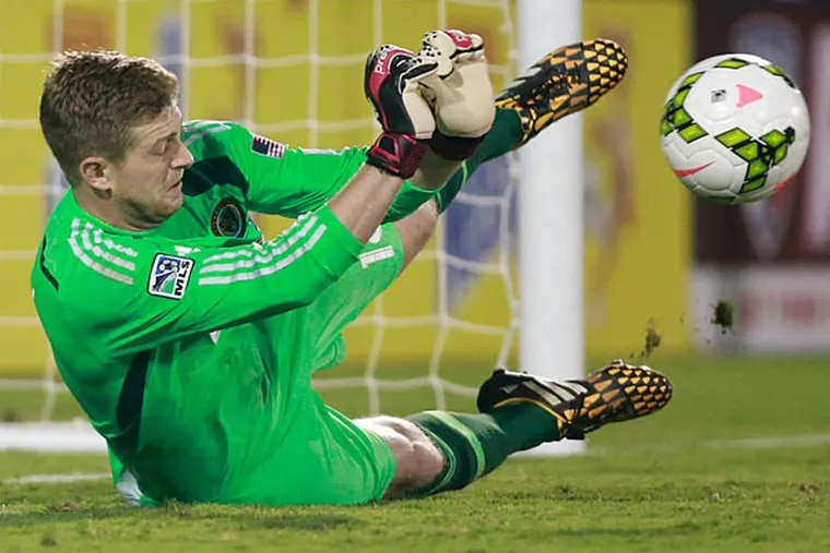 Union goalkeeper Zac MacMath (18) makes a save on FC Dallas forward Blas Perez (not pictured) during penalty kicks during the U.S. Open Cup at Toyota Stadium. Philadelphia defeated FC Dallas 4-3 on penalty kicks. (Tim Heitman/USA Today)