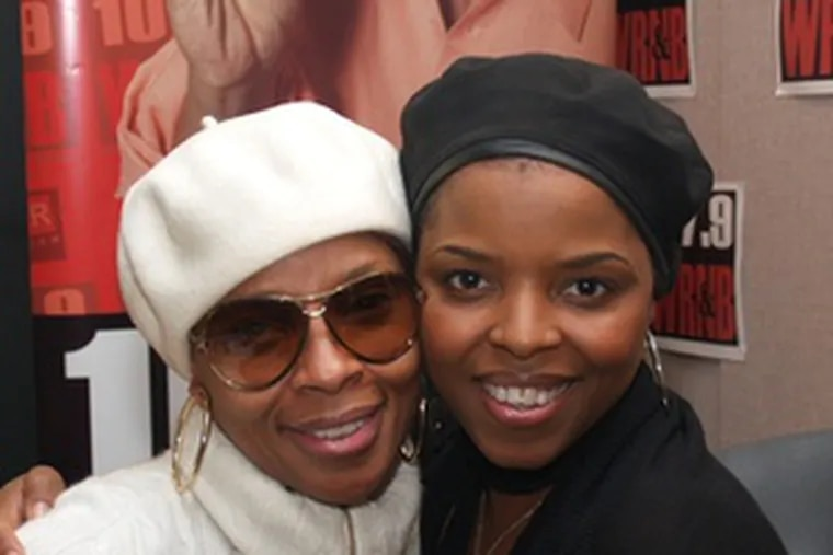 """Singer Mary J. Blige (left) with WRNB's Mo'Shay LaRen during a stop at the station last week to discuss her new album, """"Growing Pains."""""""