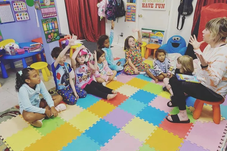 The students in Bethany Watson-Ostrowski's learning pod, where an in-person teacher supplements the school district's instruction, gather on the group's pajama day Sept. 23, 2020.