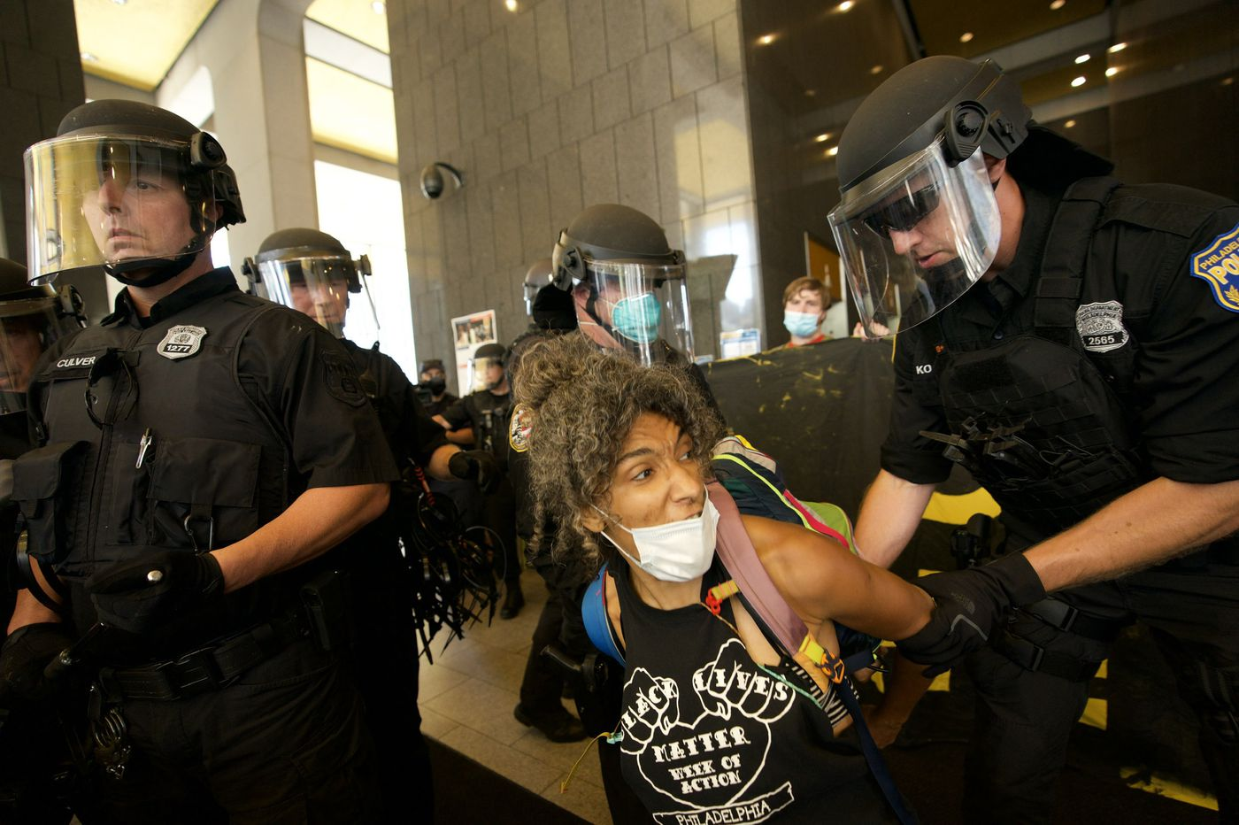Officers detain protesters calling for Philly to defund police at Municipal Services Building