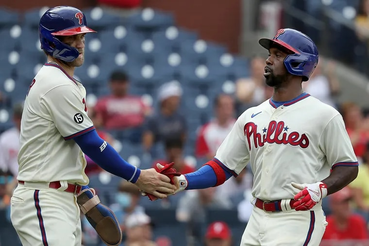 Bryce Harper (left), Andrew McCutchen (right) and the Phillies are running out of time to make their move on the Braves for the NL East.