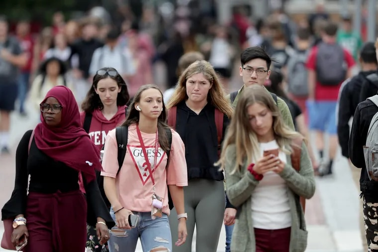 Student make their way along Polett Walk Temple University in Philadelphia, PA on August 27, 2019.