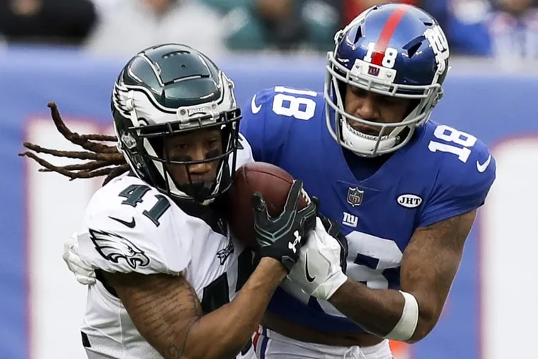 Eagles cornerback Ronald Darby intercepts the football against New York Giants wide receiver Roger Lewis during the second quarter on Sunday.