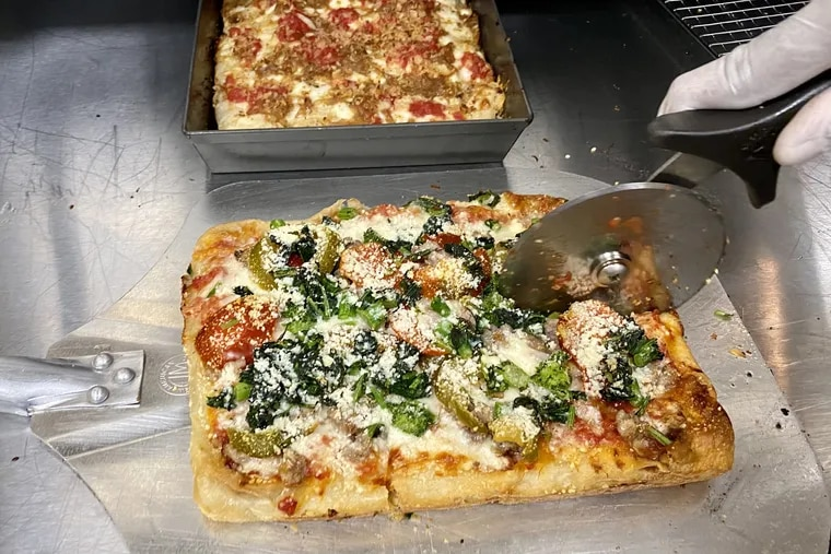 A pizza is cut up for a Benny Casanova's order. The pizza brand from chef Franklin Becker shares a kitchen in the city's Mantua section with a Middle Eastern concept called Shai.