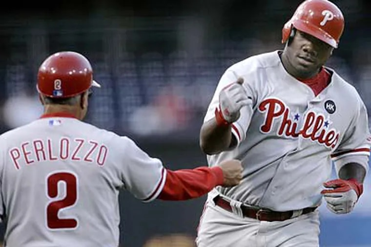 Ryan Howard's two-run homer helped the Phillies take a quick lead in the first inning. (Lenny Ignelzi/AP)