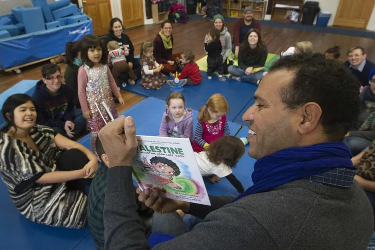 Barhim Benmbark, 39, from Morocco was asked to do the reading of children's book P is for Palestine by Golbarg Bashi, an instructor of Middle Eastern Studies at Rutgers University. The public reading was held at the Children's Community School of West Philadelphia, Sunday, December, 17, 2017.