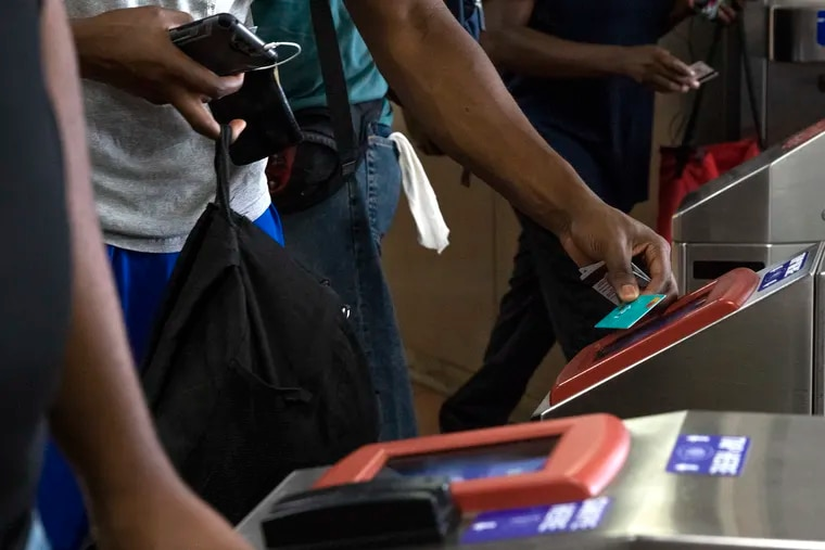 Commuters swipe their SEPTA key cards at the 69th Street Transportation Center in Upper Darby.