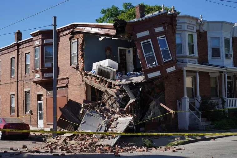 The building collapsed after a truck drove into the building at the corner of Pleasant and Musgrave Streets.