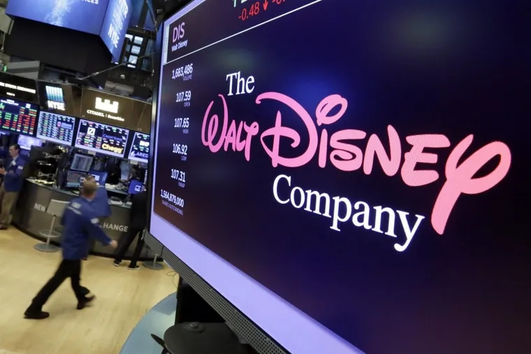 The Walt Disney Co. logo appears on a screen above the floor of the New York Stock Exchange. Disney is buying a large part of the Murdoch family's 21st Century Fox in a $52.4 billion deal, announced  Dec. 14, including film and television studios, cable and international TV businesses as it tries to meet competition from technology companies in the entertainment business.