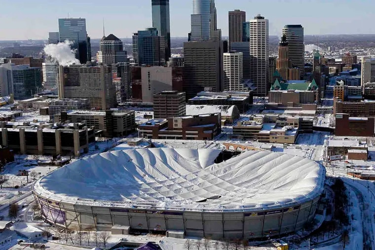 The collapsed roof over the Metrodome in Minneapolis, caved in by snow, forced the NFL to move Monday's football game between the Minnesota Vikings and the New York Giants to Detroit.