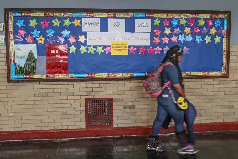 A Mitchell Elementary student is shown walking past a school bulletin board in this 2018 file photo. Some children went hungry Thursday because no cafeteria staff was available and no food was sent from the Philadelphia School District's central office.