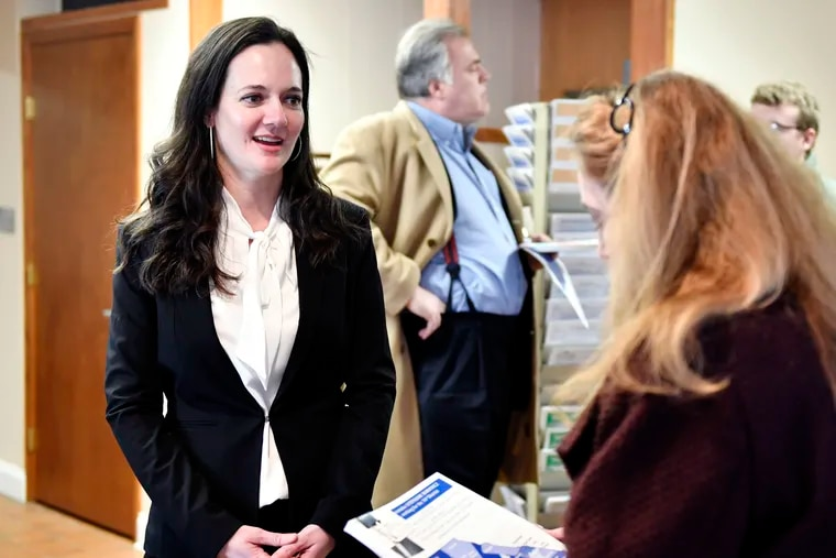 Freshman Republican State Representative Stephanie Borowicz, of Clinton County, chats with visitors during an open house at her new Milesburg office. Borowicz' passionate Christian opening prayer in the House March 25 drew complaints that it was divisive and inappropriate.  (Abby Drey/Centre Daily Times via AP)