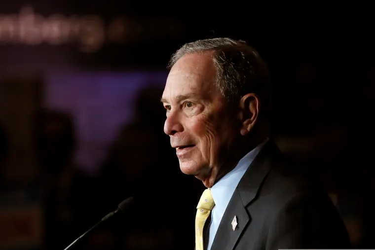 Democratic presidential candidate and former New York City Mayor Michael Bloomberg talks to supporters, in Detroit.
