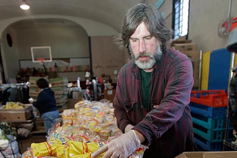 Steve Raiken, who is on welfare, volunteers at the Touch New Jersey food bank.  (Bonnie Weller / Staff Photographer)